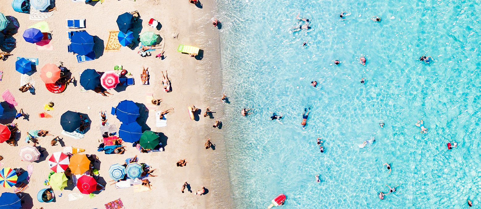 Beaches are full of sand, water, seaweed, and who knows what else. Here's your guide to surviving your summer vacation, avoiding swimmer's ear, and protecting your hearing aids.